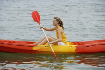 Kayaking works the shoulder, back and arm muscles.