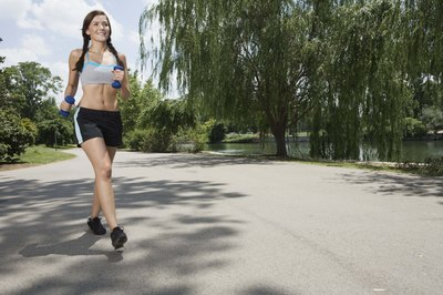 Carrying light weights adds resistance to your jogging routine.