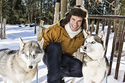 Their double coats help keep them warm, but your husky will still burn extra calories in very cold, wintry conditions.