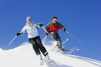 Knees bent at or about 90 degrees is the ideal skiing position.
