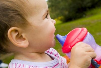 Familiarity with a sippy cup can ease the transition to using one instead of a bottle.