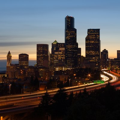 The skyline of Seattle  Washington at dusk  Interstate 5 is the freeway  that cuts through downtown and Puget Sound is visible to the left Things to Do on the Seattle Waterfront   USA Today. Dinner Seattle Waterfront. Home Design Ideas