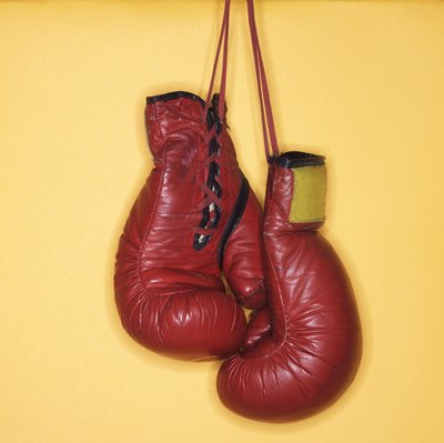 Women sometimes use men's boxing gloves.