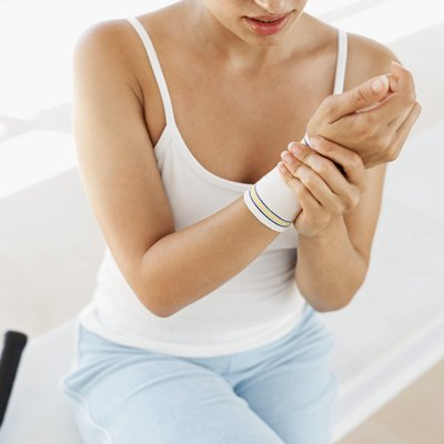 Strap up your wrists to relieve joint soreness.