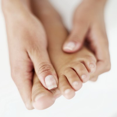 Sharp rocks can wreak havoc for flat feet when running barefoot.