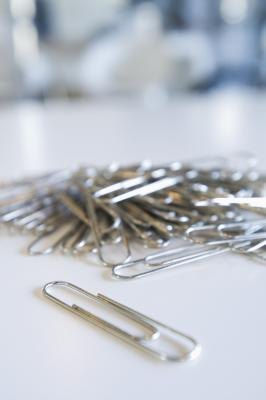 A paper clip offers a free alternative to the iPhone's SIM ejection tool.