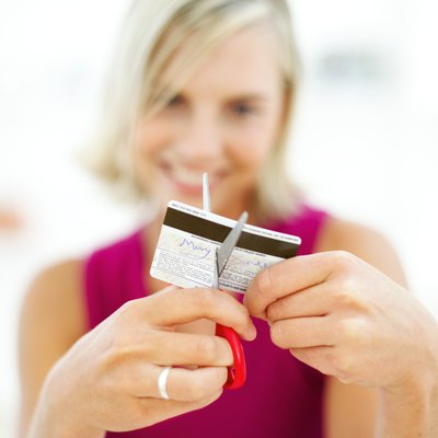 Cutting up extra credit cards is one way to limit your spending.