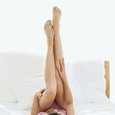 Scissor kicks can help firm up jiggly thighs.