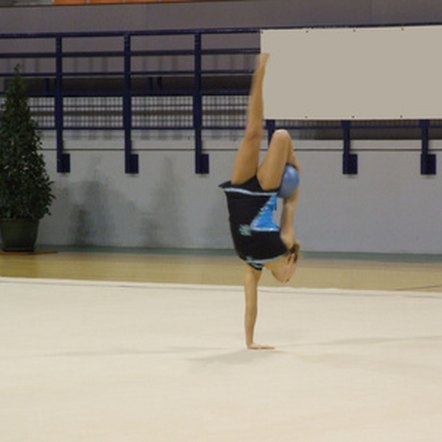 Energy from carbohydrates fuels the routines performed by teen female gymnasts.