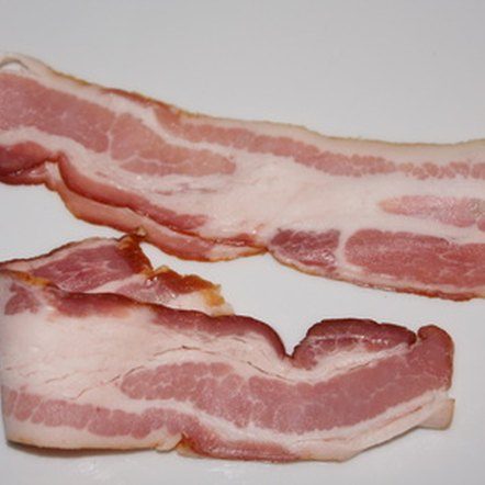 Cooking bacon kills any lurking bacteria or parasites.