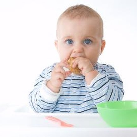 Healthy foods for a 6- to 9-month-old include rice cereal, pureed meats and smashed vegetables.