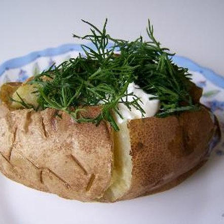 Add plenty of fresh herbs to your baked potato.