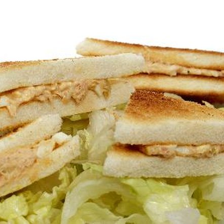 Avoid tuna sandwiches made on white bread to limit your refined carbohydrate consumption.