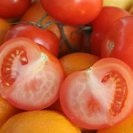 Oranges and tomatoes are both high in vitamin C.
