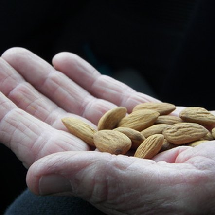 Eat a handful of almonds with your apple for a healthy snack.