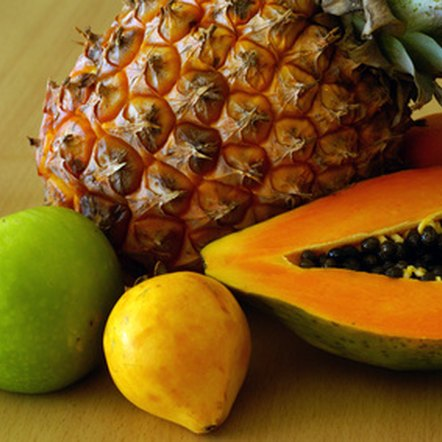 Bromelain from pineapple and papain from papaya provide numerous health benefits.