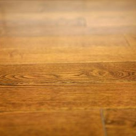 Hardwood floors may be buried under layers of linoleum and carpet.