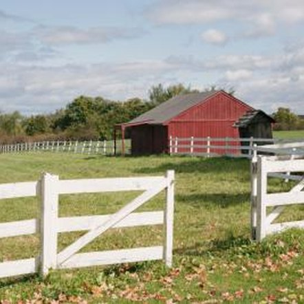 Classic wooden fences are built in 6 to 8 foot sections with posts and horizontal bars.