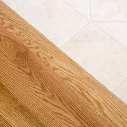 Tile-to-wood transitions need to be level for safety.