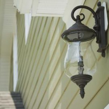 A wall plate can seal an outdoor fixture to vinyl or clapboard siding.