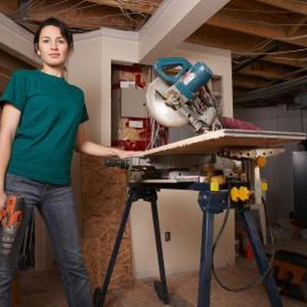 Cut and install baseboard or door casing using a miter saw.
