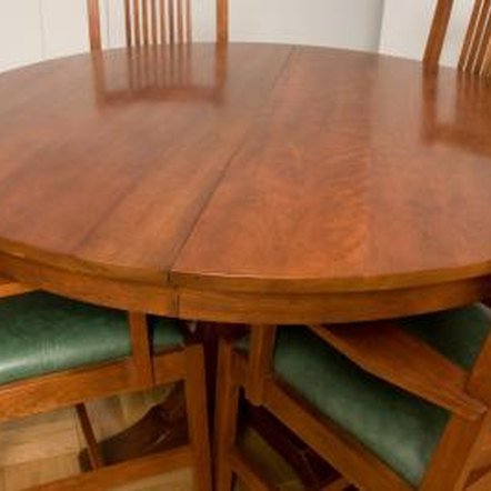 Acetone causes a dull recess on shiny wood furniture.