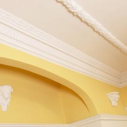Wood and plaster are often used for decorative elements on a ceiling.