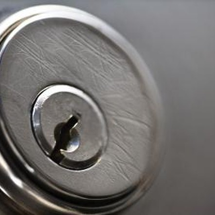 Removing the cylinder from a door lock allows you to get it re-keyed.