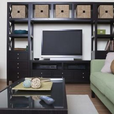 how to hide the cords of an entertainment center home guides sf gate. Black Bedroom Furniture Sets. Home Design Ideas