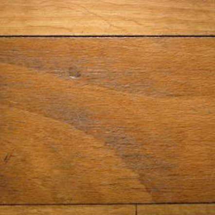 Sanding your wood floor without removing as much wax as possible can force the wax further into the wood grain.