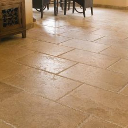 A brick pattern floor tile adds interest to a kitchen area.
