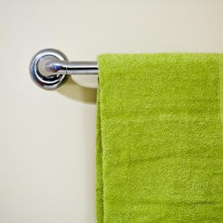Bars or hooks can be added to bathroom doors to create more room for towels.
