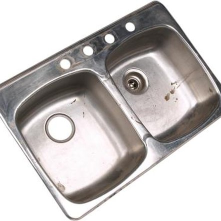 Remove a stuck drain flange from your kitchen sink.