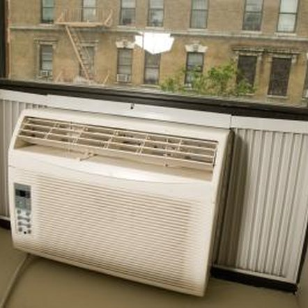 Window units drain condensation from the bottom of the unit's case.