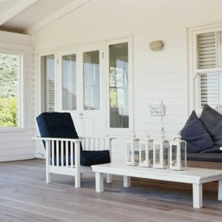 Furniture and decking can transform a carport into a porch.