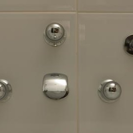 to replace a shower or tub faucet handle locate the screw that holds