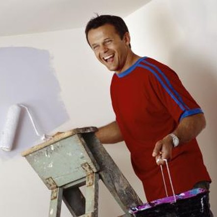 A paint roller is faster and more effective than using a brush.