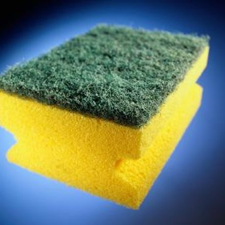 Remove grease and dirt with a scouring pad.