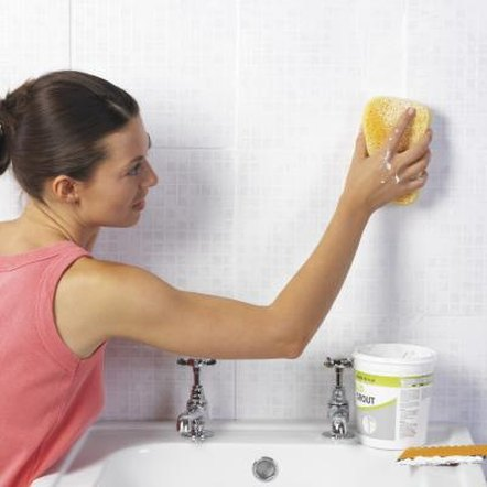 Weekly scrubbing prevents discoloration from penetrating deeply into the grout.