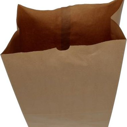 Torn brown bags can be used in place of traditional wallpaper.