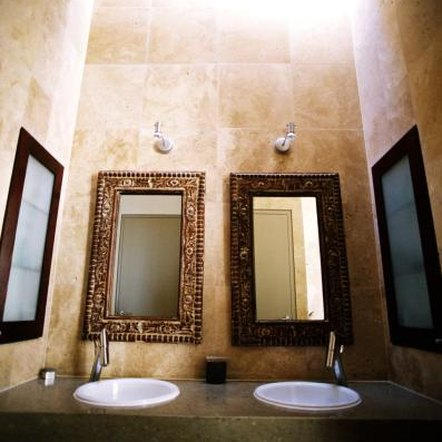 Bathroom wall colors with bronze accessories home guides for Bathroom decor earth tones