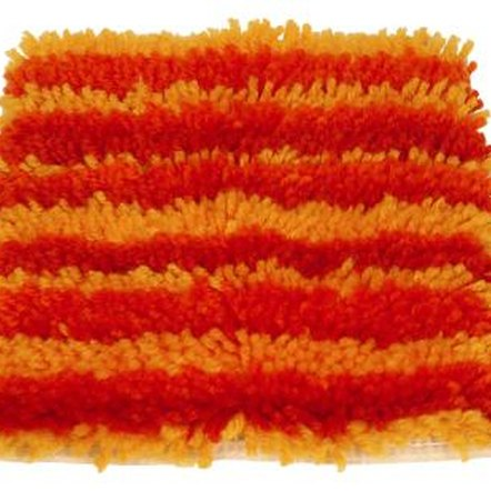 Create a shag rug to tie-in a decorative color found in the room.