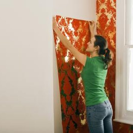 Adhesive like that used with wallpaper is needed to adhere a shelf liner to a wall.