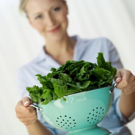 Steaming or boiling spinach can help reduce its oxalic acid content.