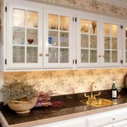 Painting oak cabinets white or cream and adding a glaze will give them a French country look.