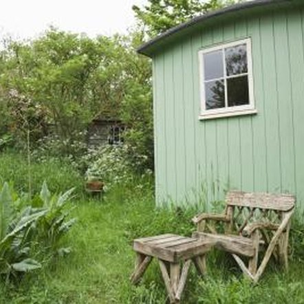 Removing vegetation from around the bottom of a garden shed reduces dampness and rot.