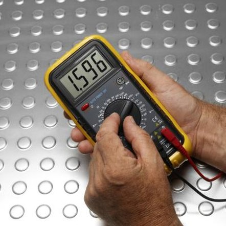 A multimeter helps you measure the ohms in a dryer igniter.