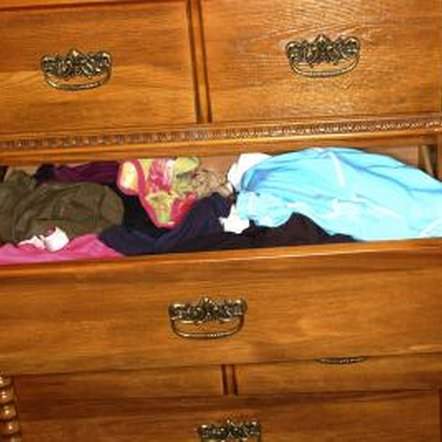 Avoid overloading drawers or pushing down on the contents when closing a drawer.