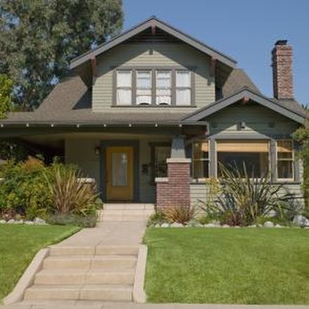 A Craftsman-style bungalow has prominent dormer windows.