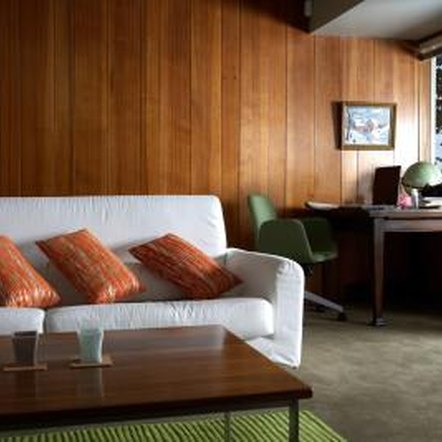 How to make a wall with wood paneling look more modern Ways to update wood paneling